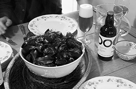Food Pairing: A bowl of mussels being served with Third Circle Saison